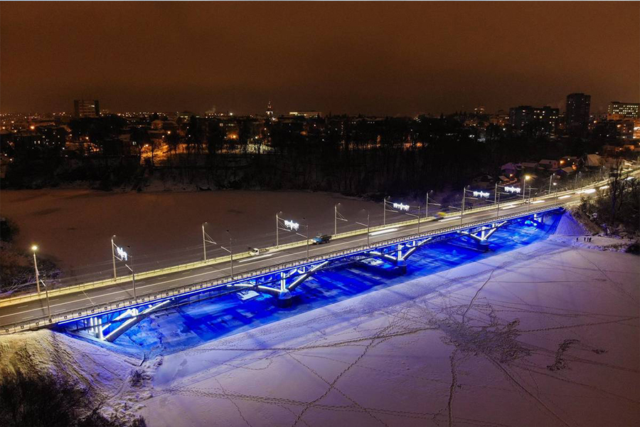 Architectural illumination of the Kyiv Bridge over the Southern Bug River.